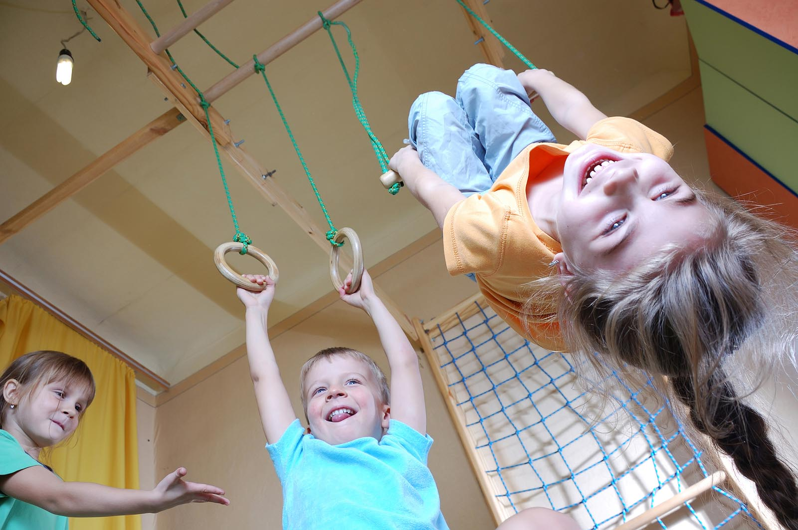 three happy 5 year old children playing together at home