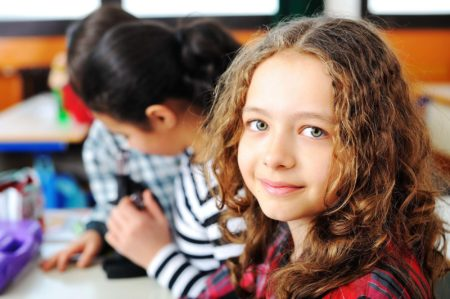 Young girl learning at school